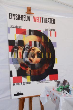 19.06.2019_Neues Plakat zum Welttheater 2020 am STEINSIEDELN-Stand